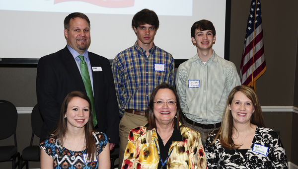 Recipients of the 2014-2015 Student and Educator of the Year awards are: Back row, middle, Payton Edwards of Montevallo High School; and far right, Christopher Robinson of Chelsea High School; and front row, from left, Meredith Goggins of Montevallo High School, Sharee Winslett of Vincent Elementary and Ashli Polizos of Oak Mountain Middle. Pictured with the winners, back row, far left, is Kevin Morris with America's First Federal Credit Union. (Reporter Photo/Neal Wagner)