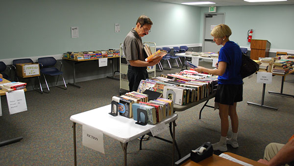 Customers browse through the book sale inventory at the Jane B. Holmes Public Library in Helena. (Reporter Photo/Graham Brooks)