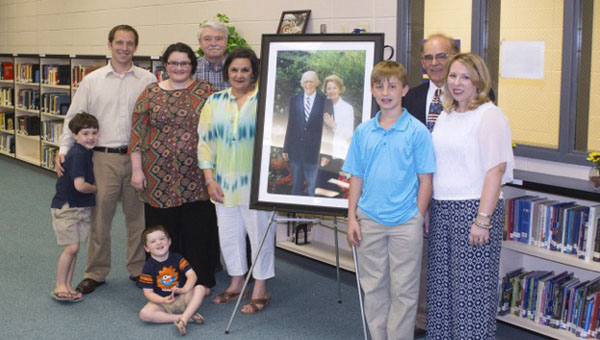 The library at Chelsea High School is now known as the Col. and Mrs. John Ritchie Learning Commons in honor of a former teacher and his wife. The couple's son, Frank Ritchie, second from right, is a math teacher at CHHS. (Contributed)