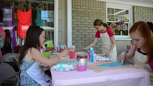 Girl's are focused on painting their custom owls at a birthday party on Saturday, April 11, at Helena's new Party Art store in Old Town Helena. (Reporter Photo/Graham Brooks)