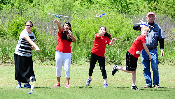 Thompson Intermediate School gifted students toss their rubber band-powered model planes into the air at Alabaster's Limestone Park on April 22. (Reporter Photo/Neal Wagner)