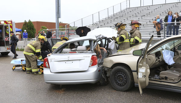 Emergency responders extract Chelsea High School students from the scene of a simulated car crash during the Every 15 Minutes program on April 16 at the school. (Contributed/Dawn Harrison)