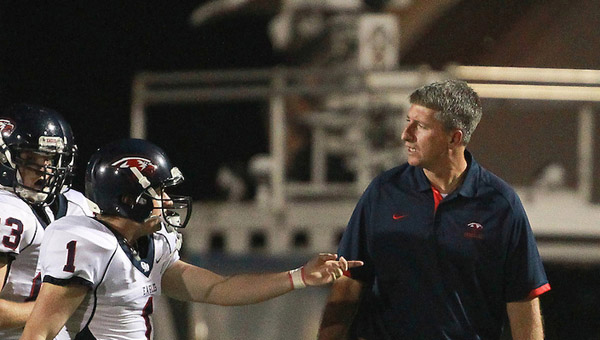 Oak Mountain head football coach Chris Bell and his Eagles will look to build off the success of their 10-2 campaign in 2014. (File)