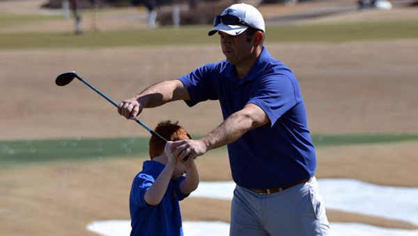 Robbie Blackwell, shown here with one of his junior golfers, has been teaching golf to youngsters ever since he was 23 years old. (Contributed)