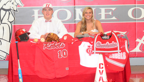 Walker Holmes, left, and Payton Stephens both signed with Huntingdon College on May 12. Holmes will play baseball for Huntingdon while Stephens will join the cheerleading squad. (Reporter Photo / Baker Ellis)