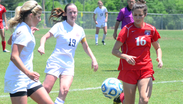 Alexandra Dunn and Sydney Jeter battle for a loose ball during Oak Mountain's May 2 second-round matchup with Vestavia Hills. The Lady Eagles won the game after three rounds of penalty kicks to advance to the Final Four. (Reporter Photo / Baker Ellis)