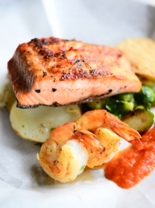 The grilled salmon plate includes brussel sprouts and poached Gulf shrimp.