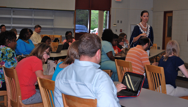 HCS technology integration coach Jamie Nutter talks with third through fifth grade parents about the Chromebook laptops students will bring home this summer. (Reporter Photo / Molly Davidson)