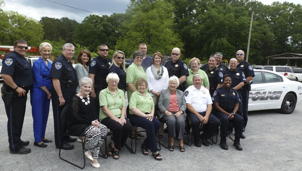 The Novella Club of Columbiana treated the Columbiana Police Department to a day of appreciation. Pictured are: (back row) Michael Bradberry, Jean Lowe, Mark Robinson, Rachel Bell, Kenneth Reavy, Lisa Dodson, Sherry Atchison, K/C. Handley, Scarlott Lowe, David Galutza, Sallie Lawshe, Jeff Bowers, David Alexander, David Orth, Mike Peppers; (front row) Pat Ponder, Janice Key, Becky Moore, Bonnie Atchison, Chief Lamar Vick and Sasha Lilly Knighten. (Contributed)