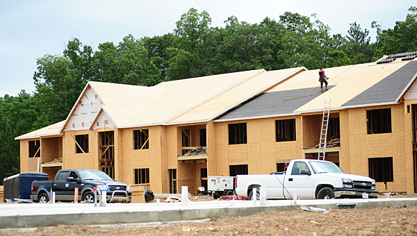 Construction crews work to build to the new Grand Reserve apartment complex off Huntley Parkway in Pelham on May 27. (Reporter Photo/Neal Wagner)