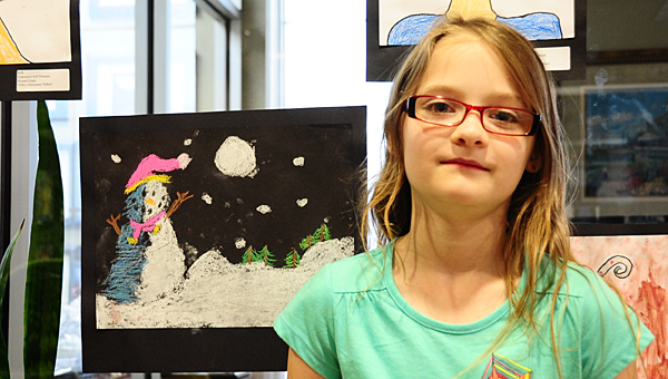 Valley Elementary School second-grader Sara Rowe displays her snow scene drawing at Pelham's IberiaBank during a May 12 reception. (Reporter Photo/Neal Wagner)