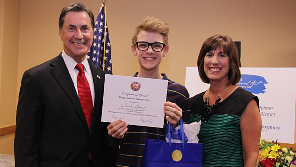 Pelham High School junior Aaron Squires, center, was honored during a May 4 ceremony at the Hoover Public Library. (Contributed)