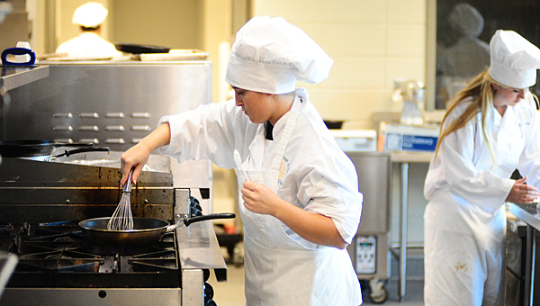 Pelham High School student Medison Ledford prepares food during a culinary competition at the school on May 7. (Reporter Photo/Neal Wagner)