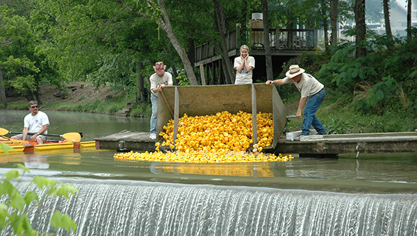 "The Buck Creek Festival Committee will unveil a new ""Duck Dumper"" this weekend at the festival's annual Duck Race. (File)"
