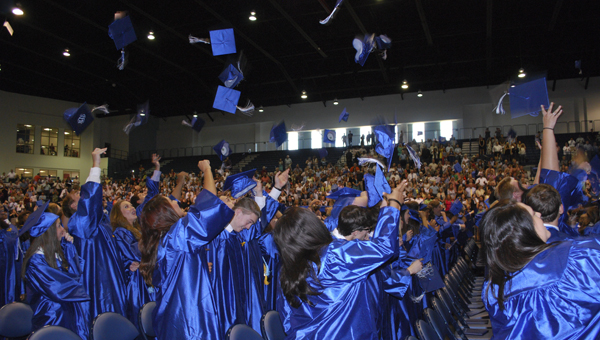 Chelsea High School students toss their graduation caps in the air following a May 19 commencement ceremony at Samford University. (Reporter Photo/Emily Sparacino)