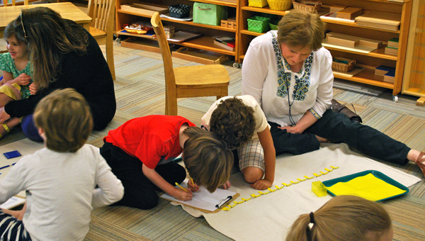 Loved ones worked alongside students on school activities during Grandaprents and Special Friends Day at Hilltop Montessori School. (Reporter Photo / Molly Davidson)