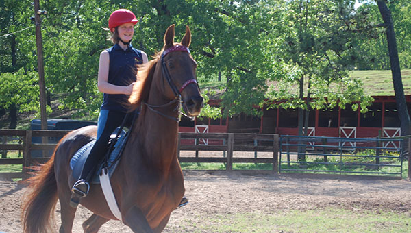 Emma Farnlocher takes a ride on her horse Cadillacs Crystal at Rocking S Farm for an afterschool riding lesson. (Reporter Photo/Graham Brooks)
