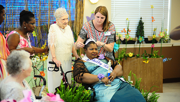 Shelby Ridge Nursing Home employee Sarah Hadder secures 2015 Miss Shelby Ridge Carolyn Blunt's crown as reigning Miss Shelby Ridge Bessie Smitherman, third from right, looks on. (Reporter Photo/Neal Wagner)