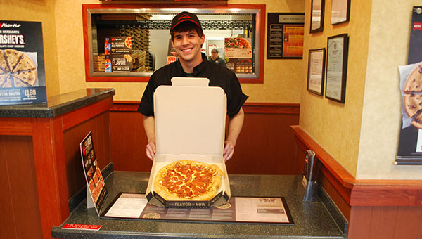Helena Pizza Hut General Manager Ben Hitt has been donating excess pizza to a local charity ever since becoming manager. (Reporter Photo/Graham Brooks)