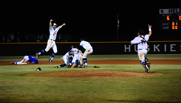 Helena players celebrate after recording the last out to defeat St. Paul's to advance to the state championship game in Montgomery. (Reporter Photo/Graham Brooks)