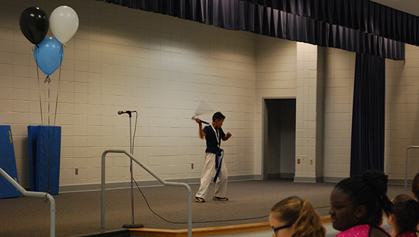 Juan Chavero shows off his nunchuck skill at the HIS fifth grade talent show. (Reporter Photo/Jennifer Bailey)