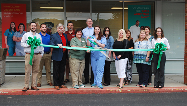A ribbon cutting ceremony was held on Tuesday, May 19, for It's About Time Urgent Care in Helena. (Reporter Photo/Graham Brooks)