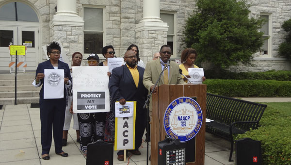 Members of Shelby County and area NAACP chapters held a press conference in front of the Shelby County Courthouse on May 12 to announce dates and details for voting rights events in Shelby County in June. (Reporter Photo / Emily Sparacino)