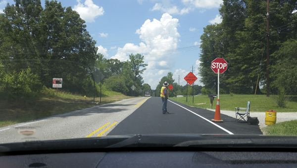 A resurfacing project on Chelsea Road (Shelby County 47) is close to being finished. The final stages are striping and installing rumble strips. (Reporter Photo/Emily Sparacino)