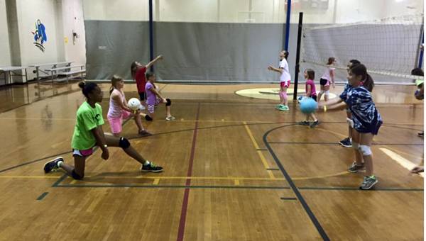 Campers play volleyball in the gym of the Pelham YMCA. The Pelham branch of the YMCA has activities and camps each week all through the summer for children ages five to eighth grade. (Contributed)