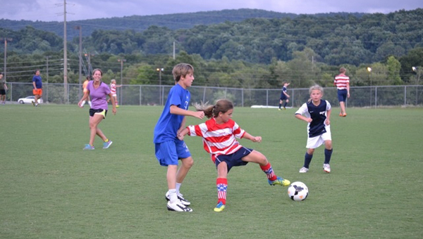 Players battle for possession during a game in the 2014 Dynamic Develpoment Soccer Camp. The second annual camp is set to run from June 22-26 this year. (Contributed)
