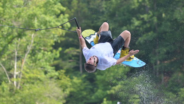 Calvin Miller, a rising senior at the University of Alabama, executes a backflip at Flipside Watersports in Oak Mountain State Park on June 10. (Reporter Photo / Baker Ellis)