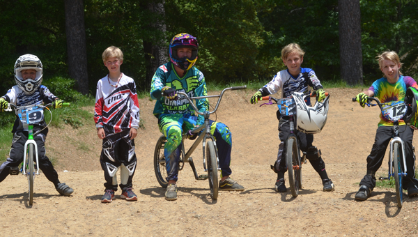Oak Mountain State Park BMX bike riders pause to smile for a photo. From left: Cooper Holly, Whitaker Bourn, Austin Bowman, Sawyer Holly and Stephen Tally.