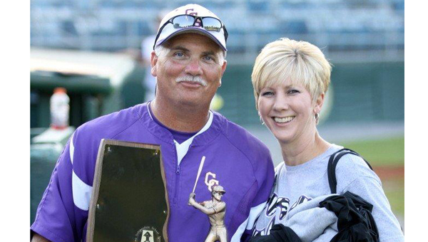 Tim Smith, shown here holding the 2012 AISA A baseball state champhionship trophy, is the head baseball and football coach at Cornerstone Christian School and has served as the school's only athletic director for 18 years. (File)