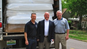 Jonathan Smidt, Keith Krininger and John McNeil stand in front of a truckload of mattresses donated to Big Oak Ranch. (Reporter Photo / Molly Davidson)