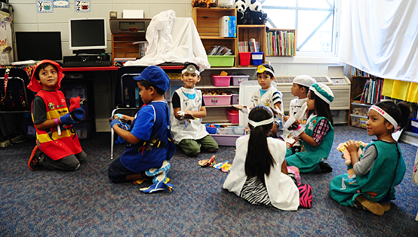 English language learner students in Jodi Richardson's ESL summer camp class at Meadow View Elementary School dress up as several types of public servants on June 25. (Reporter Photo/Neal Wagner)
