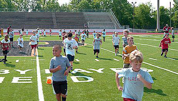 Pelham High School Football coaches will be hosting its youth football camp, training kids in skills such as individual positions and team concepts. (Contributed)