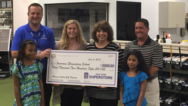 The PGA Tour Superstore donated $3,250 to both Inverness Elementary and Greystone Elementary schools to start golf programs during a June 4 friends and family opening event. (Contributed / Benny Rose)