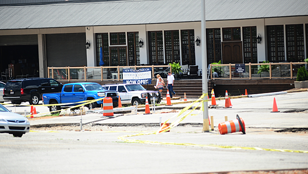 Customers exit the new Summer Classics showroom off U.S. 31 in Pelham on June 3. The company is in the process of repaving its large parking lot and adding a new entrance off U.S. 31. (Reporter Photo/Neal Wagner)