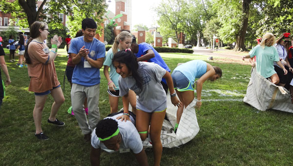 """High school students involved in this year's Walsh Academy of Leadership finish a team sack race during an """"Amazing Race"""" competition on the University of Montevallo campus. (Reporter Photo/Emily Sparacino)"""