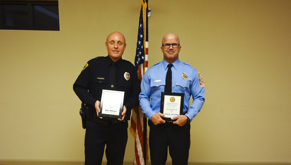 Mike Williams, left, and John H. Meredith were honored as Pelham's Police Officer and Fireman of the Year recipients at an American Legion Matthew Blount Post 555 dinner June 4. (Reporter Photo/Emily Sparacino)