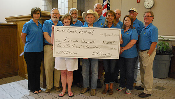 Members of the Buck Creek Festival Committee present a check valued at $22,640 on Monday, June 15, from funds raised from the 2015 Buck Creek Festival. (Reporter Photo/Graham Brooks)