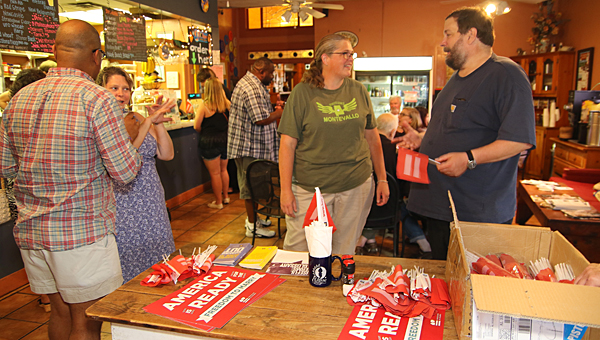 Same-sex marriage supporters gathered at Eclipse Coffee and Books in Montevallo on the night of June 26 to celebrate a Supreme Court order requiring states to issue same-sex marriage licenses. (Special to the Reporter/Eric Starling)