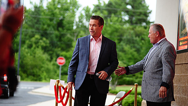 """Stephen Baldwin, center, walks down the red carpet during the premiere of """"Faith of our Fathers"""" at Alabaster's Amstar Cinema on June 30, as former state Sen. Hank Erwin, right, looks on. (Reporter Photo/Neal Wagner)"""