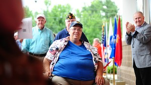 """Local veterans receive the red-carpet treatment during the June 30 premiere of """"Faith of our Fathers"""" at Alabaster's Amstar Cinema. (Reporter Photo/Neal Wagner)"""