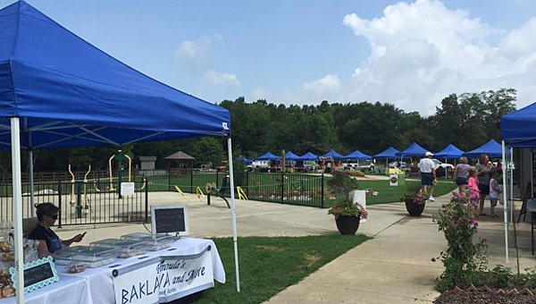 Visitors peruse stands of locally grown produce at Alabaster's farmers' market on June 20 near the Alabaster Senior Center. (Contributed)