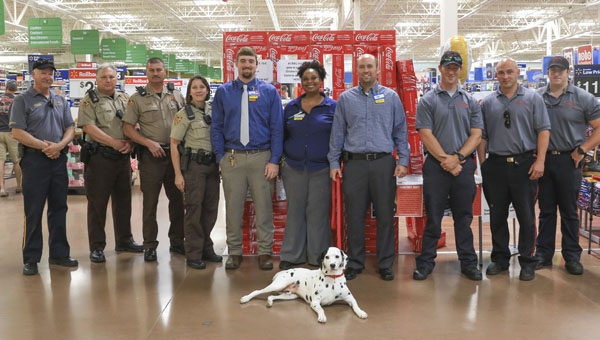 "Chelsea Fire & Rescue's firehouse dog, Hero, was ""arrested"" June 6 at Walmart in Chelsea during a fundraiser for Children's Hospital in Birmingham. All donations made to bail Hero out of jail will go to the hospital. (For the Reporter/Dawn Harrison)"