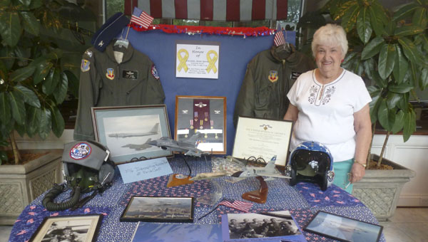 First Baptist Church of Columbiana member and Hall of Memories volunteer stands in front of Veteran Col. Gene Quick, U.S. Air Force (Retired), Hall of Memory display at Liberty Day 2014. (Contributed)