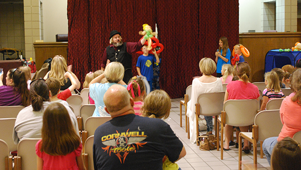 Dewayne Reynolds wowed kids and parents during his balloon show at Helena City Hall on Wednesday, June 10 for the summer reading kickoff party. (Reporter Photo/Graham Brooks)