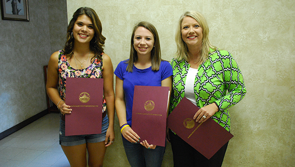 Recent Montevallo High School graduates Lupe Serrano and Meredith Goggins are presented a resolution by Rep. April Weaver, commending them on their heroic actions to help save the lives of three young swimmers at Perdido Beach. Not pictured are Kayla Smith and Katie Hamrick. (Reporter Photo/Graham Brooks)