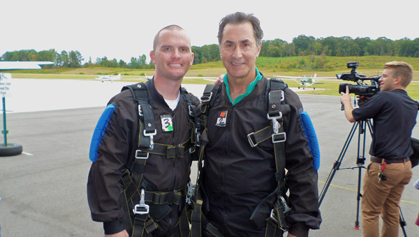 Dustin Chandler and Gary Palmer return after jumping out of a plane during the Sept. 27, 2014 Skydive 4 CDKL5 event at Skydive Alabama. (File)